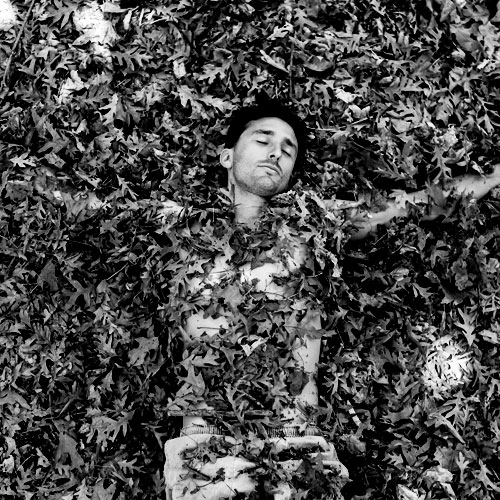 Andrew Ucles laying in leaves