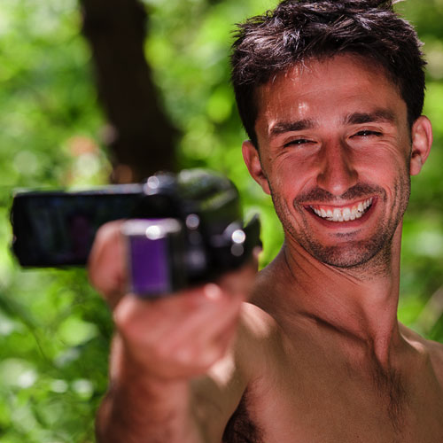 Andrew Ucles laughing into a camera