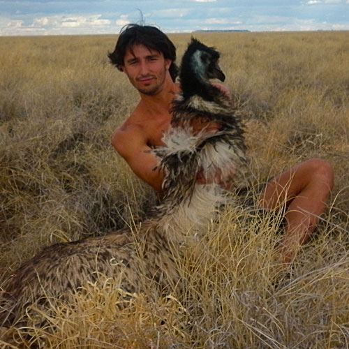 Andrew Ucles with an emu