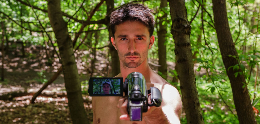Andrew Ucles holding a camera