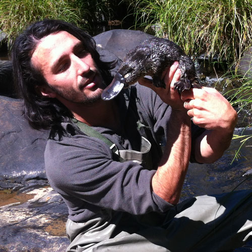Andrew Ucles holding a Platypus