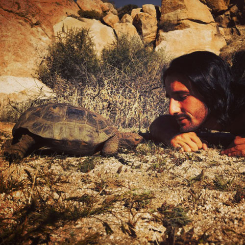 Andrew Ucles with a Tortoise