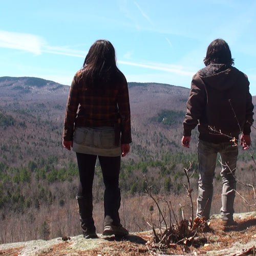 Andrew Ucles and Laura Zerra overlooking a cliff